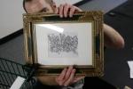 Rick Darnell showcases ready-to-borrow art from a local Tenderloin artist